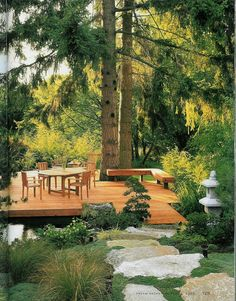 deck over pond, boulder steps, towering firs, Japanese-y foreground, beautiful light.  Dream Decks & Patios, page 129