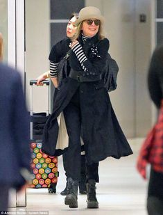 Signature look: Diane Keaton was spotted at JFK Airport in New York on Monday, wearing a tan version of her favorite accessory, the bowler hat