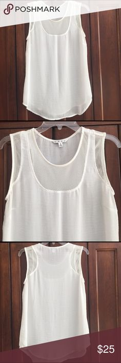 CAbi sleeveless white top. With mesh around sleeves and neck.  Loose fitting. CAbi Tops Tank Tops