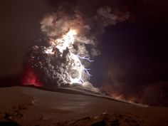 A bright bolt of lightning crackles within the ash cloud from the eruption of the Eyjafjallajökull volcano in Iceland in April 2010.  Volcanic lightning occurs when roiling ash particles rub against each other and become electrically charged.
