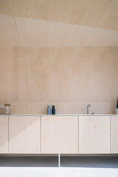 Kitchen with cabinet, wall and ceiling built using birch plywood. In the project Büro …