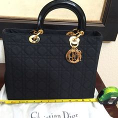 NEW 18k gold plated hardware Christian Dior Lady D NWT Authentic Lady Dior handbag. Elegant and Classy! Absolutely Amazing! It's to die for... Leather handle and extra strap for crossbody style and gold Dior charms! 13 inches long. TV is 3999. Pls check my 2nd listing for more close up pictures Dior Bags Crossbody Bags