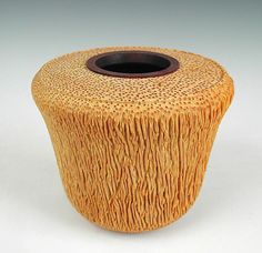 Palm Hollow Form 1595  byDewey Garrett  Small turned palm wood vessel that is accented with a rim of turned walnut