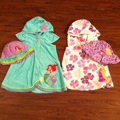 Girls' swim suit cover ups and hats Worn, but in good condition. Ariel is size 7/8 and Repunzel is size 5/6 Disney Swim Coverups