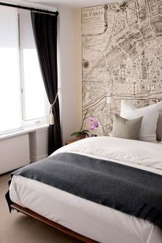 simplicity of bed against complexity of Paris map - wonderful juxtaposition here!