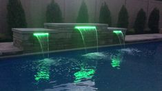 """Fiberglass swimming pool when they added in a sheer descent alongside the pool. Call us at to learn more on how to enjoy your well-deserved """"Life of Leisure. Swimming Pool Landscaping, Small Swimming Pools, Small Backyard Pools, Backyard Pool Designs, Swimming Pools Backyard, Swimming Pool Designs, Outdoor Pool, Swimming Videos, Small Patio"""