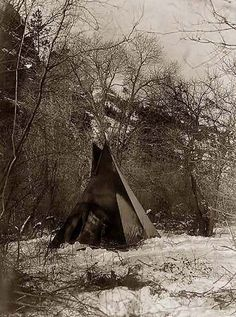 Here for your perusal is a highly creative photograph of a Sioux Tipi in a Winter Indian Camp. It was created in 1908 by Edward S. Curtis.    The photo illustrates a Sioux tepee beside trees in the snow.    We have compiled this collection of photographs mainly to serve as a valuable educational resource. Contact curator@old-picture.com.    Image ID# 64FA79A6