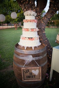 country wine barrel wedding cake stand decor / http://www.himisspuff.com/rustic-country-wine-barrel-wedding-ideas/9/