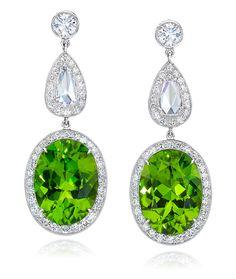 Cellini Jewelers Oval Peridot Drop Earrings. Set in 18 karat White Gold.