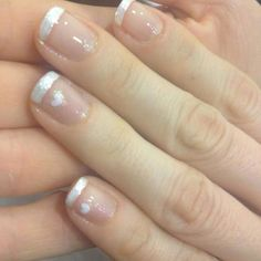 My handy work ... French manicure with white heart detail