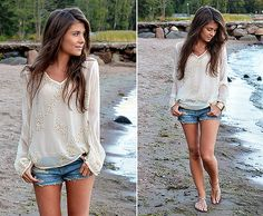 Feminine flirty top with jean shorts-perfect beach attire.