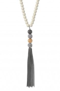 love the color combo and added length the beads give the tassel