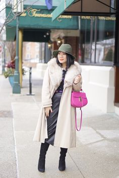 Petite fashion winter street style + cream fur coat + olive hat+ black faux leather pencil skirt+ pink bag