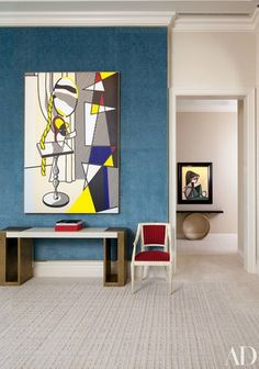 In the living room of Steve Wynn and wife Andrea's Manhattan duplex, decorated by Roger Thomas, a 1977 Roy Lichtenstein canvas hangs above an Hervé Van der Straeten console from Ralph Pucci International; a 1958 Picasso painting is displayed in the hall.