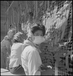 Making camouflage nets for the War Department, Manzanar Relocation Center, 1 July 1942, Dorothea Lange, public domain via Wikimedia Commons.