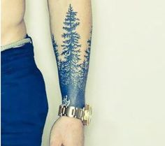 Spruce tree forearm tattoo