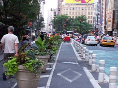 Short thick bollards in New York, NY. Good ways to separate bike and pedestrian traffic could be a post of its own.