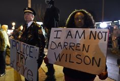 Here Are The Most Powerful Photos From The Ferguson Protests- Former head of police joins protestors in Ferguson