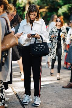 The best street style from MBFWA. Including loose tracksuit pants with a Prada bag and chunky sneakers on Carmen Hamilton.