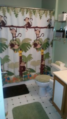 Shower curtain and monkey curtain hangers to boot. There is a matching waste basket and soap dispenser too.