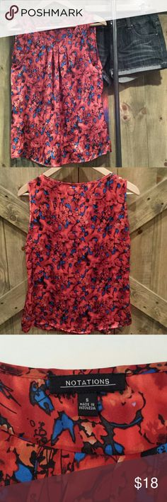 Sleeveless Blouse Too cute satin like blouse. red with blue and other colors. bright and beautiful#! pair with jean shorts blue denim or white. no rips no stains no snags. excellent condition Tops Blouses