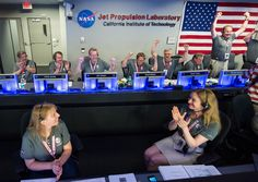 Celebrating Juno's Arrival at Jupiter The Juno team celebrates after receiving confirmation from the spacecraft that it had successfully completed the engine burn and entered orbit of Jupiter Monday July 4 2016 in mission control of the Space Flight Operations Facility at the Jet Propulsion Laboratory. The Juno mission launched August 5 2011 and will orbit the planet for 20 months.