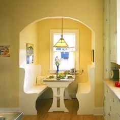 this could be the breakfast nook that was in my in-laws kitchen, right down to the wall of cabinets to the right