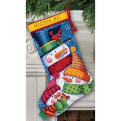"""A colorful array of cotton thread is used to stitch this wintry Freezin' Season Stocking design. Pompoms and tassels add a dimensional touch. Kit contains 14 mesh printed canvas, cotton thread, wool yarn, needle, polyester felt for stocking back, and instructions including an alphabet for personalizing. Finished Size: 16"""" long (41cm). Designed by Debra Jordan Bryan. © Debra Jordan Bryan."""