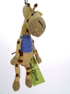Giraffe Shamwari Keyring - This Twza (Giraffe in Shona) wants to be your Shamwari (friend!)  Each animal is lovingly and completely handmade and has as much individuality and character as the lady who knitted it!  It comes with its own name and a picture of the woman who made it.  $14.00