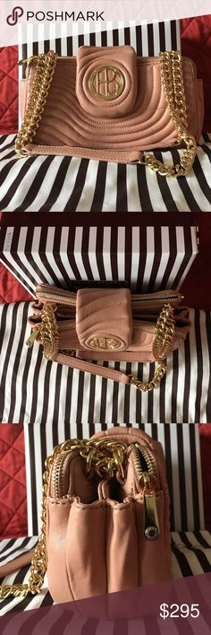 Henri Bendel Soho Mini Henri Bendel No.7 Soho Mini. This is so cute and definitely a head turner. HB logo in flap closure. Chain strap. Strap is adjustable so it can be use as a short shoulder bag or can be wear long, however this can't be wear as a cross body bag. Two zip compartments on both side and two more compartments in the middle. Tag says color pink but i would say more on a Dusty pink color (refer to photos) I will provide more photos for serious buyer. Marks on back part. OFFERS…