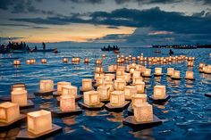 Lantern Festival, Honolulu, Hawaii ~ Floating Lanterns memorialize those that have passed away. As the sun sets in the background, small boats with Buddhist monks and church volunteers help to launch and shepherd the small armada of lanterns ships. Floating Lantern Festival, Floating Lanterns, Floating Lights, Paper Lanterns, Candle Lanterns, Sky Lanterns, Paper Lamps, Candle Bags, Floating Boat
