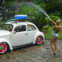 girl Washing VW beetle