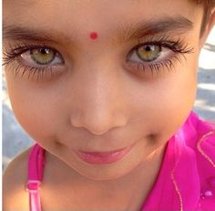 A beautiful Indian girl - Just look at the expression of inner-joy in those mesmerizing eyes!
