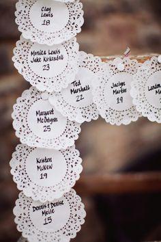 paper lace escort card at wedding reception