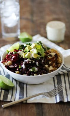 Quinoa, beet, and black bean burrito bowls with caramelized onions and cumin-lime tahini