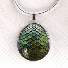 Hey, I found this really awesome Etsy listing at https://www.etsy.com/listing/129854232/green-dragon-egg-pendant-game-of-thrones