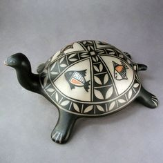 Mary Janice Ortiz. Cochiti Pueblo pottery. Turtle with Fish Motif Medium: Natural Handmade Clay and Pigments Dimensions: 4 1/2″ H x 10″ L x 7″ W. https://www.wrightsgallery.com/product/turtle-with-fish-motif/