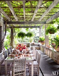 Perfect for entertaining: Outside there are numerous escapes, like this pergola covered wi...