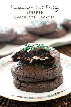 Peppermint Patty Stuffed Chocolate Cookies >> by Tastes of Lizzy T's. 5 ingredient cake mix cookies with York Peppermint Patties baked inside. These Peppermint Patty Stuffed Chocolate Cookies are soft and have a deep chocolate and mint flavor.