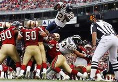 Ladainian Tomlinson leaping over his O-line and the 49ers D-line.  Just awesome.