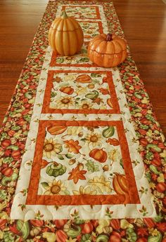 This cheery quilted table runner was made with fabrics from a collection aptly named Happy Harvest. The blocks down the center feature sunflowers,