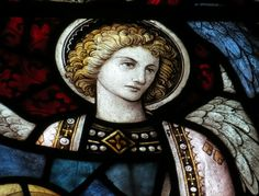 Stained Glass window detail. Cartmel Priory Cumbria. Photographed by Moira Clark.