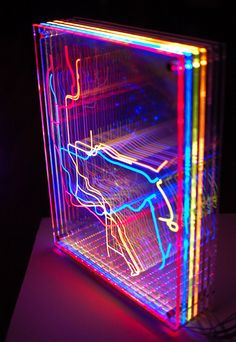 """""""In Transit: NYC"""" is an animated light sculpture featuring a series of laser-cut, edge-lit panels depicting the NYC Subway map."""