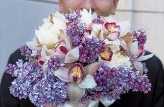 Lavender lilacs, blush pink cymbidium orchids and white peonies wrapped in ivory raw silk. Floral & Decor: http://KehoeDesigns.com, Photography: Ron Manville