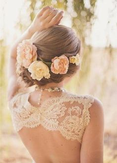 Side Low Bun With Flowers Summer Hair Styles For Wedding