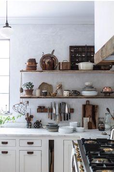 Open kitchen shelving, brass accented range.