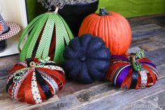 "These precious pumpkins feature 12"" x 12"" sheets of patterned and glitter paper adhered back to back and cut into strips. The strips are connected with brads, one at the top and one at the bottom, and the stem is a simple wooden spool."