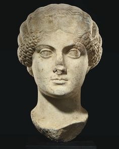 A ROMAN MARBLE PORTRAIT HEAD OF THE EMPRESS AGRIPPINA MINOR  CIRCA 50 A.D.