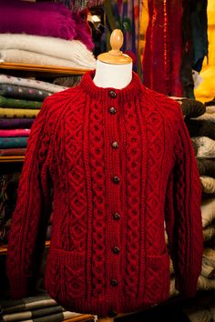 Ladies hand knit Aran cardigan. Pictured in Cranberry.