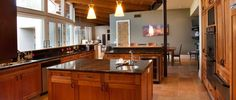 This beautiful #KitchenRemodel includes warn wood tones and stunning natural light